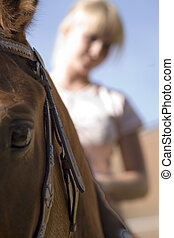 proud - blond  woman with her own brown horse