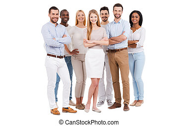 Proud to be a team. Full length of multi-ethnic group of people in smart casual wear looking at camera and smiling while standing against white background