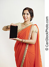 Proud woman showing tablet
