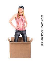 Proud woman standing in a cardboard box
