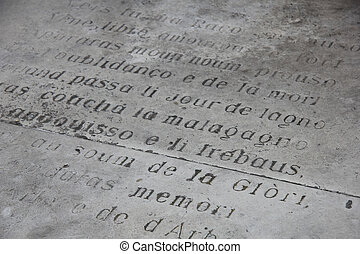 Detail of a inscripted stone in Provencal dialect
