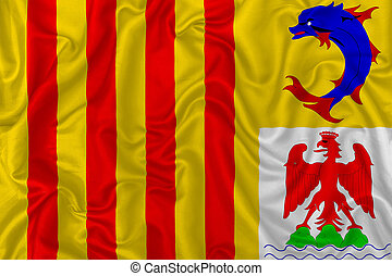 Provence-Alpes-Cote d'Azur territory flag on wavy silk textile fabric background.