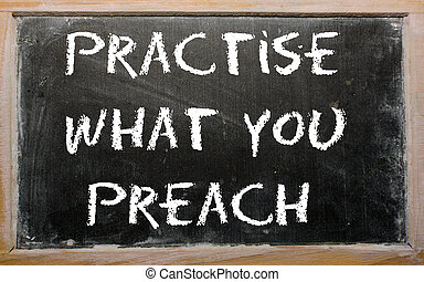 "Proverb ""Practise what you preach"" written on a blackboard -..."