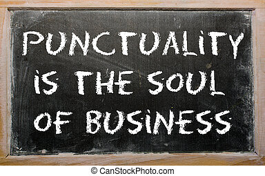 """Proverb """"Punctuality is the soul of business"""" written on a black"""