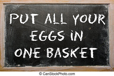 """Proverb """"Put all your eggs in one basket"""" written on a blackboar"""