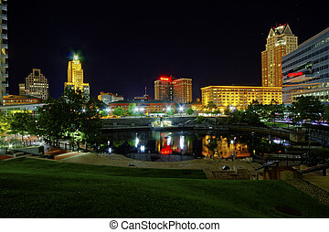 HDR image of Providence Place in the center of the capital of Rhode Island with reflections of buildings on the water at night