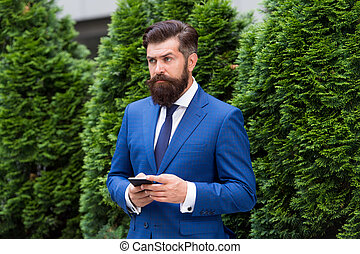 Providing feedback. serious businessman with smartphone. agile business. bearded man on business meeting. using modern technology. modern look of ceo. responding email. always online. have problems