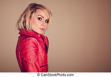 Provocative Fashionable Blonde Woman dressed in a leather...