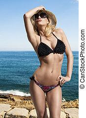provocative girl in bikini
