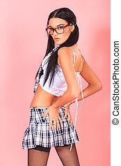 provocative girl - Sexy student girl posing over pink...