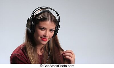Provocative young brunette posing with headphones