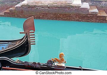 prow closeup - gondolas prow detail in a Venice narrow canal
