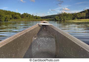 prow of canoe - prow of a canoe navigate on a lake