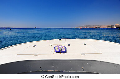 Prow Of White Boat With Flip-flops In The Red Sea