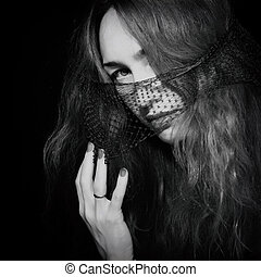 Young beautiful woman in the veil