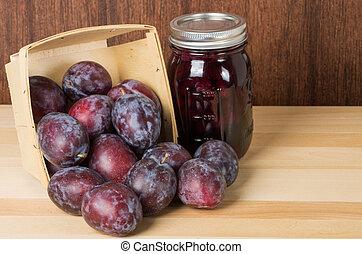 Prune plums with jar of jam - Prune plums in wooden ...