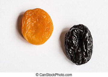 prunes and dried apricots on a white background