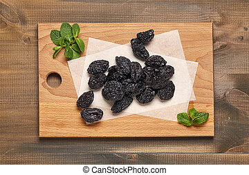 Prunes with green leaf.