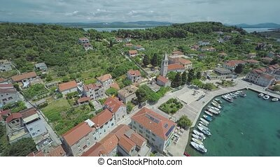 Prvic Luka aerial - Aerial ascending view of the Prvic Luka...