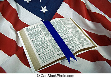 Open Holy Bible on American flag.