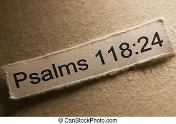 Picture of a paper with psalms 118:24 written on it.