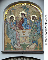 """PSKOV, RUSSIA - MARCH 08: Mosaic gate icon """"Old Testament Trinity"""" designed by E. Klimov and made in 1942 in Germany, was established in 2003 above Pskov Kremlin gate in March 08, 2015"""