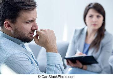 Psychiatrist diagnosing patient