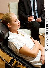 psychiatrist examining a female patient