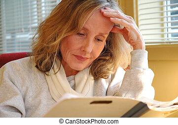 Psychiatrist working in her office.