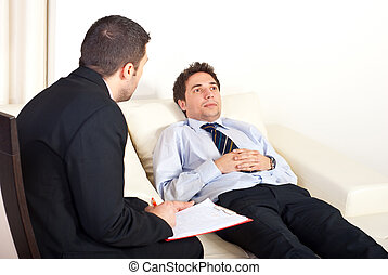 Psychiatrist with male patient - Psychiatrist man talking...