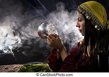 Psychic Holding a Crystal Skull - Female psychic or fortune ...