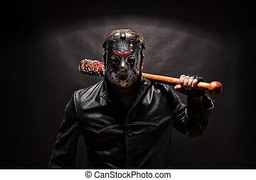 Psycho killer in hockey mask with bloody bat on black background.