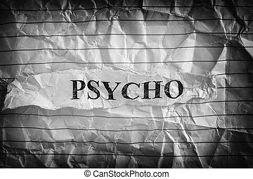 Psycho. Torn piece of paper with the word Psycho