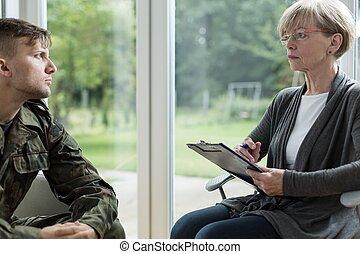 Psychologist helping soldier - Image of psychologist helping...