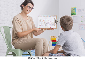 Psychologist holding picture