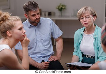 Psychologist listening member of group - Photo of female...