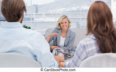 Psychologist speaking to a couple
