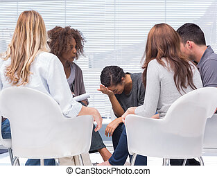 Psychologist taking notes while woman crying