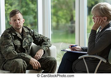 Psychologist talking with despair soldier