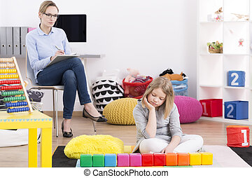 Psychologist testing girl with Asperger's - Female...