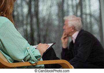 Psychotherapist listen to her elderly client