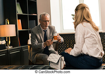 Psychotherapist sitting in front of his female patient