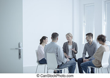 Psychotherapist talking with couples