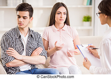 Psychotherapy - Psychologist helping to young couple in her...