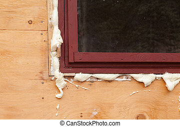 Polyurethane foam fills in gap at window just inserted in opening