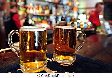 Pub in New Zealand - Two cups of beer in a pub in New...