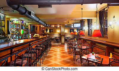 Pub interior - Interior of a modern pub in orange and wooden...