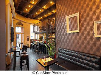 Pub interior - Interior of a pub with furniture during day.