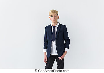 Puberty concept - Teenage boy portrait on a white background.