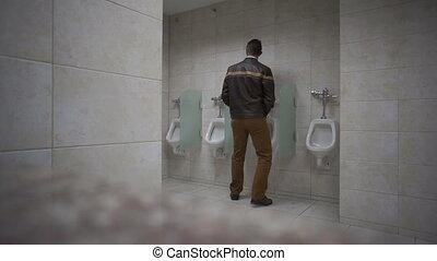 Public Bathroom Man Uses Urinal